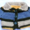 baby jacket/sweater; two snap closure on inside of lapel.